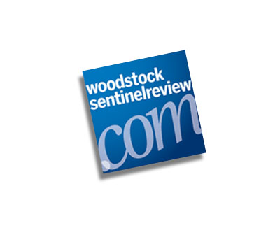 Woodstock Sentinel Review logo